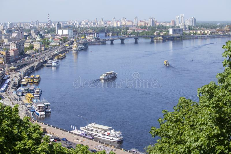 Pleasure boats on the Dnepr River and river shore in historical area. Kiev, Ukraine. KIEV, UKRAINE - MAY 05, 2018 : Pleasure boats on the Dnepr River and river royalty free stock photo