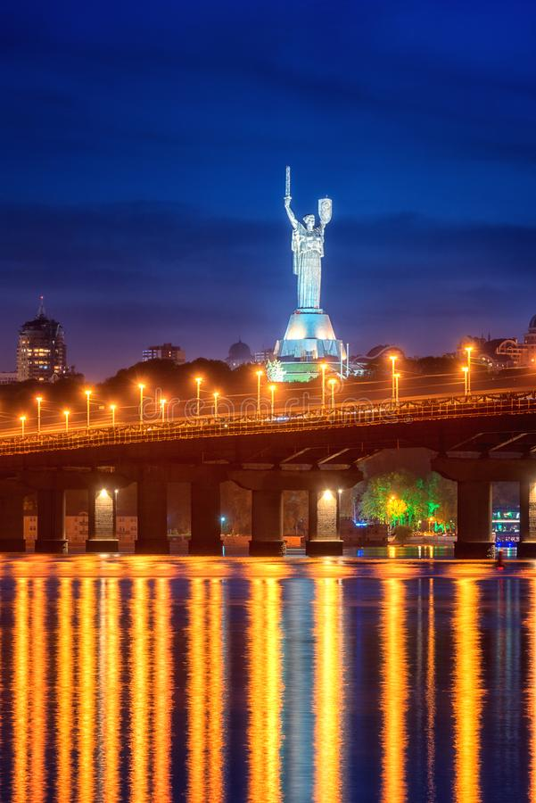 Kiev, Ukraine - May 04, 2018: View of the Paton bridge, Motherland monument and Dnieper river at night, beautiful cityscape stock photo