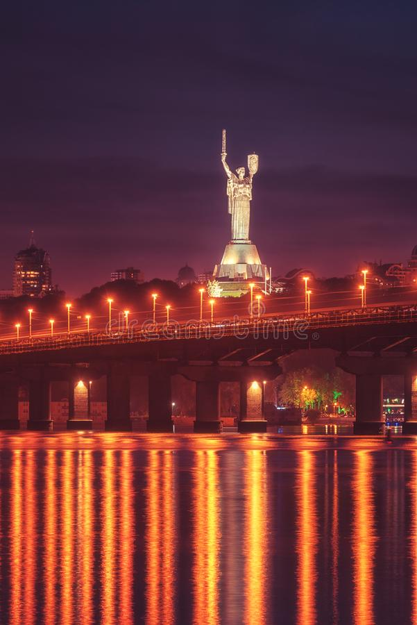 Kiev, Ukraine - May 04, 2018: View of the Paton bridge, Motherland monument and Dnieper river at night, beautiful cityscape royalty free stock images