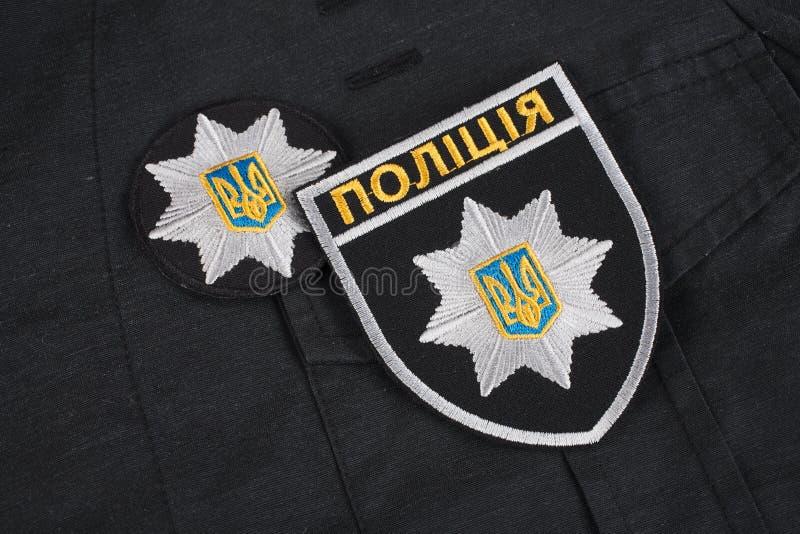 KIEV, UKRAINE - NOVEMBER 22, 2016. Patch and badge of the National Police of Ukraine on black uniform background royalty free stock photos