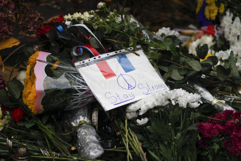 KIEV,UKRAINE - November 14, 2015: People lay flowers at the French Embassy in Kiev in memory of the victims terror attacks in Pari. People lay flowers at the stock images