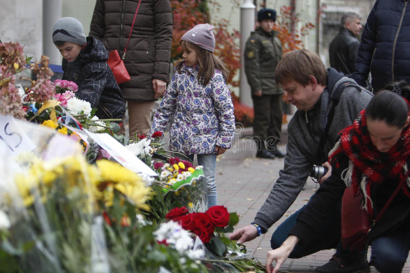 KIEV,UKRAINE - November 14, 2015: People lay flowers at the French Embassy in Kiev in memory of the victims terror attacks in Pari. People lay flowers at the royalty free stock photography