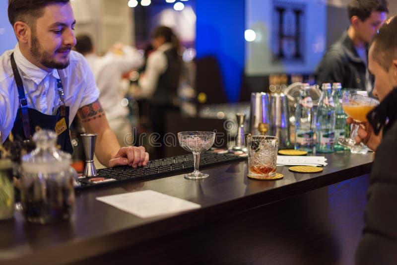 KIEV, UKRAINE - 30 OCTOBER, 2016: Barman festival. Young handsome bartender is making cocktail. KIEV, UKRAINE - 30 OCTOBER, 2016: Barman festival. Young royalty free stock photo