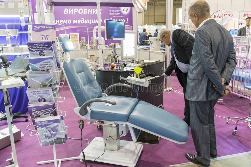 Kiev, Ukraine. October 5 2018. exhibition of dental equipment. Group dentist chair and tools at the international exhibition of th royalty free stock photo