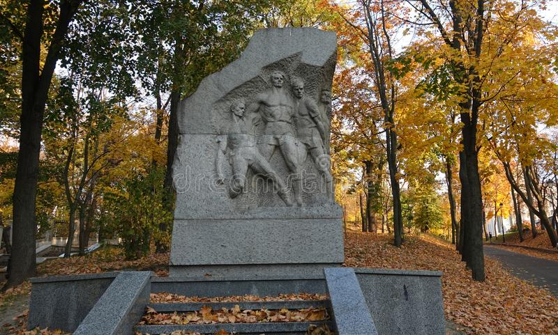 Monument to shot football players of Dynamo Kyiv in Mariinsky Park. Autumn day royalty free stock photography