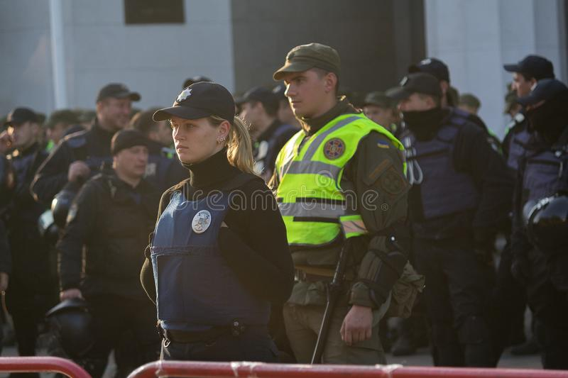 Kiev, Ukraine - October 18, 2018: Police woman standing in cordon guarding the parliament royalty free stock image