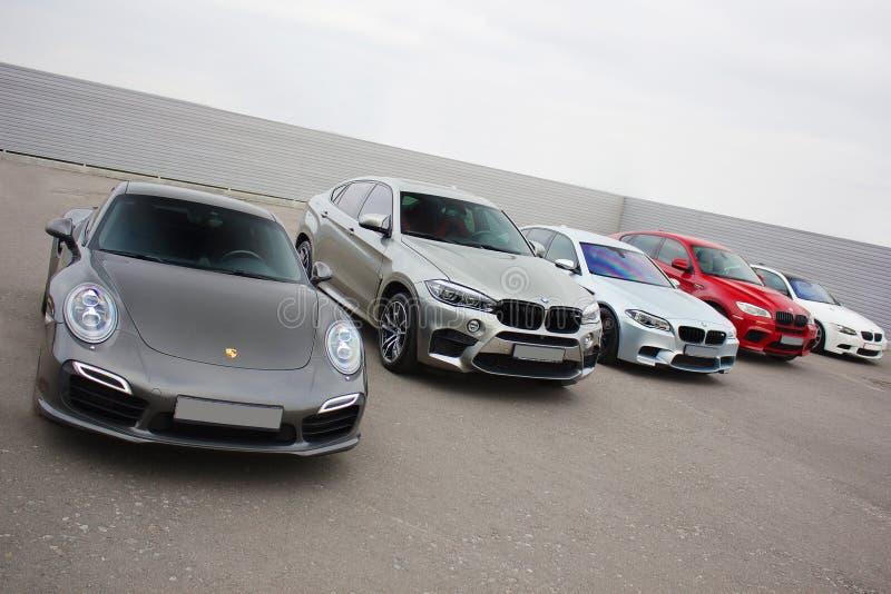 Kiev, Ukraine; October 17, 2016; Super combo supercars. Porsche 911 Turbo S & 2x BMW X6 M & BMW M3 E92. Street racing. Drag royalty free stock photo