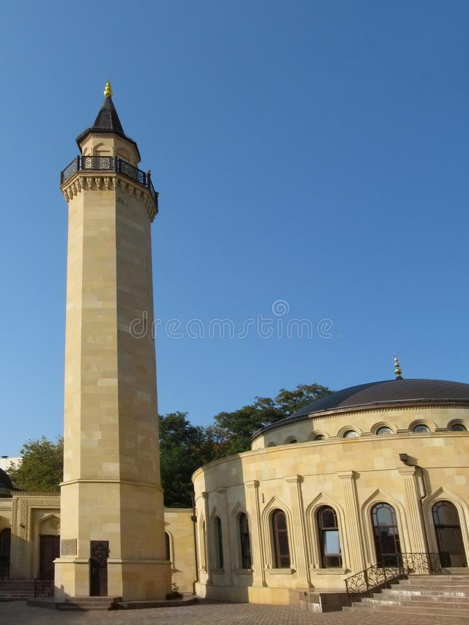 Tall beige minaret of the Ar-Rahma Mosque, vertical photo royalty free stock image
