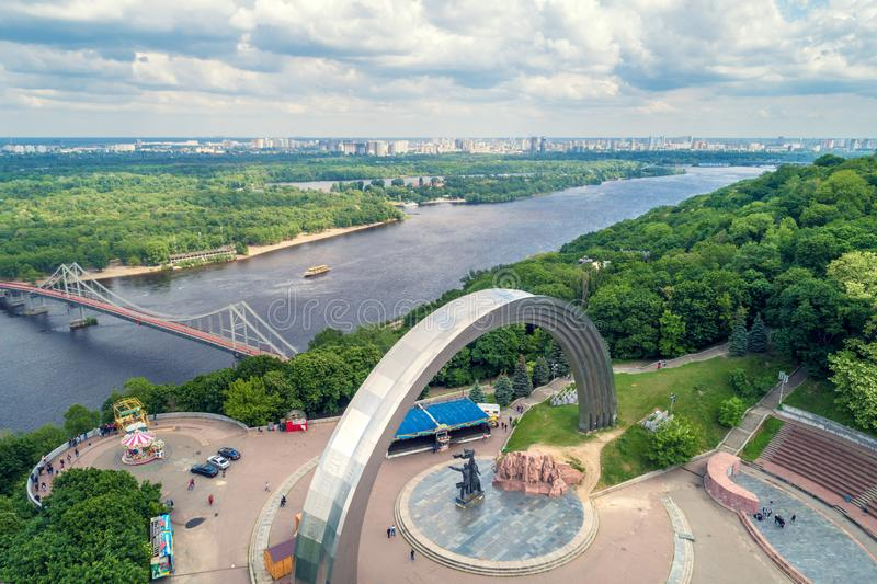 Panoramic view of Dnepr river, pedestrian bridge and the People`s Friendship Arch Arka druzhby narodiv. Kiev, Ukraine 13.5.2018. Panoramic view of Dnepr river royalty free stock photos