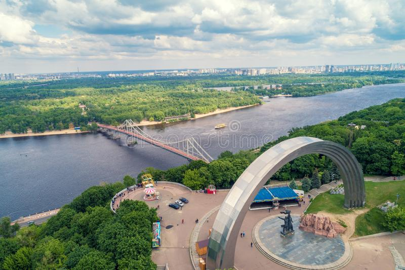 Panoramic view of Dnepr river, pedestrian bridge and the People`s Friendship Arch. Kiev, Ukraine 13.5.2018. Panoramic view of Dnepr river, pedestrian bridge and royalty free stock photography