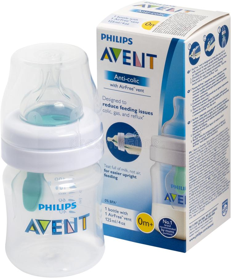 KIEV, UKRAINE - September 25, 2019: Feeding bottle with Philips Avent Anti-Colic AirFree valve. The nipple is always filled with m. Ilk, even if the bottle is royalty free stock photos