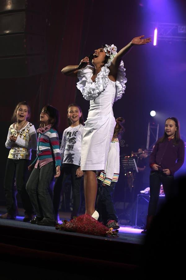 Kiev, Ukraine, 12.04.2011 Ukrainian famous singer Jamala. Sings on the stage with children stock image