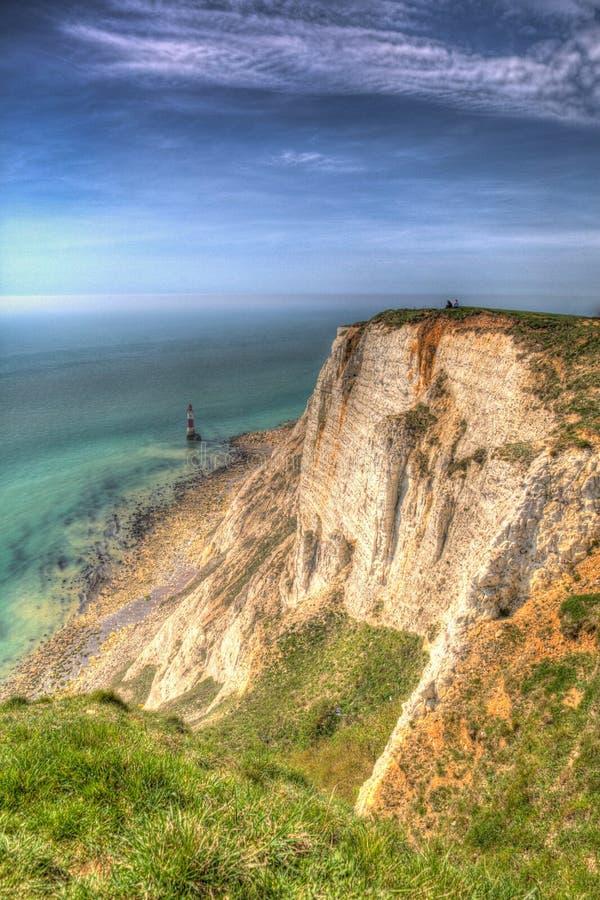 Kiezelachtig Hoofd Oost-Sussex Engeland het UK met vuurtoren in kleurrijk HDR stock foto's