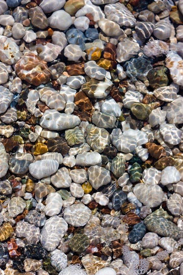Kiezelstenen en water royalty-vrije stock afbeelding