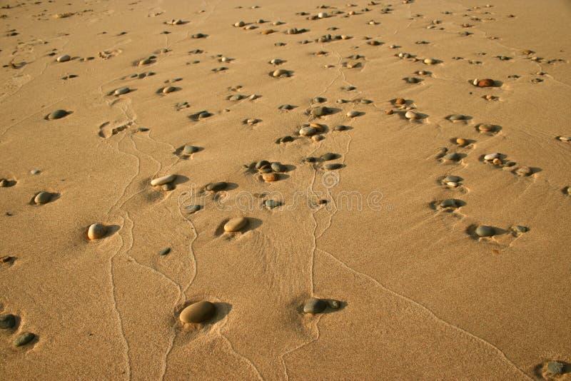Kiezelstenen in Zand 1 royalty-vrije stock afbeeldingen