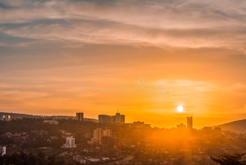 Kigali city centre skyline and surrounding areas under a golden sky at sunset. Kigali city centre skyline buildings and surrounding areas under a golden sky at royalty free stock photography