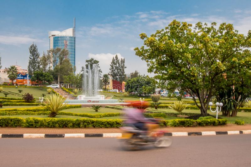 Kigali, Rwanda - September 20, 2018: A `moto` motorbike at a roundabout near the city centre, with Kigali City Tower in the back stock photo