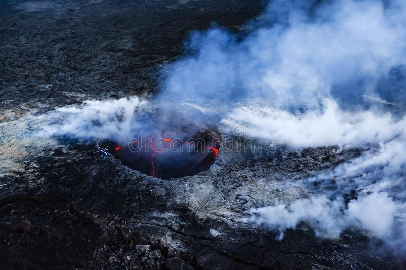 Kilauea Caldera spewing steam and gases during eruption 2018 on. Hawaii in National park royalty free stock photography