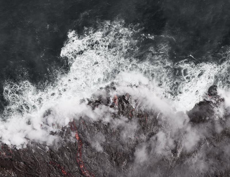 Kilauea lava enters the ocean, expanding coastline. stock photos