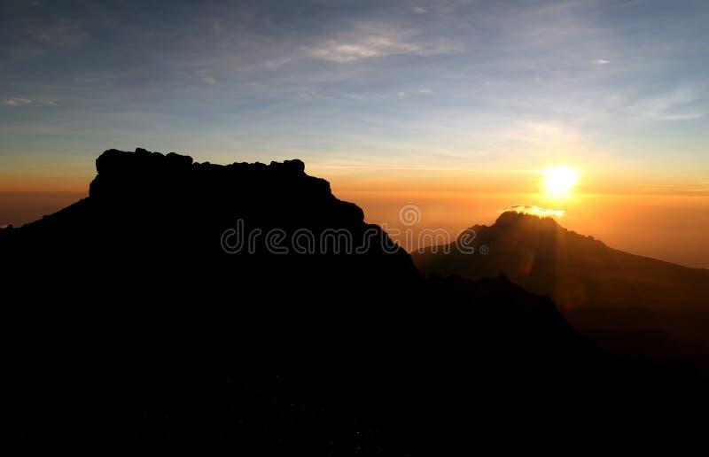 Kilimanjaros Sonnenaufgang lizenzfreies stockbild