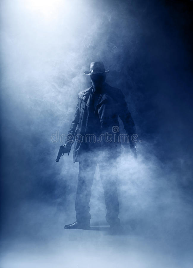 Killer without a face. Faceless killer in the haze royalty free stock images