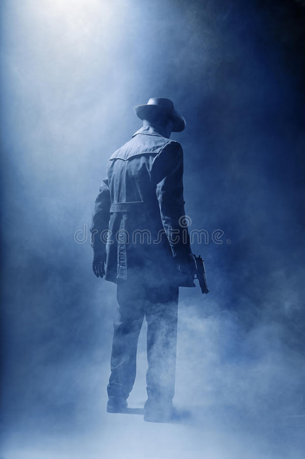 Killer. Faceless killer in the haze stock photos