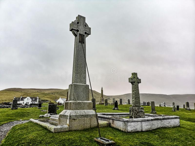 Kilmuir, Scotland - October 25 2019 : The grave of Flora MacDonald is located on Kilmuir cemetry on the Isle of Skye. KILMUIR, SCOTLAND - OCTOBER 25 2019 :The royalty free stock photo