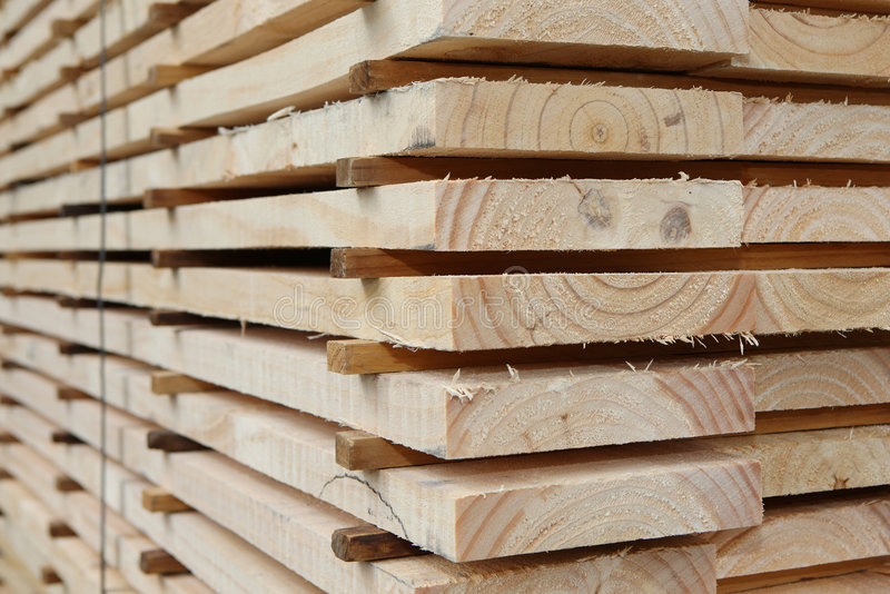 Kiln Dried Timber Planks. Stacked timber planks after kiln drying process royalty free stock image