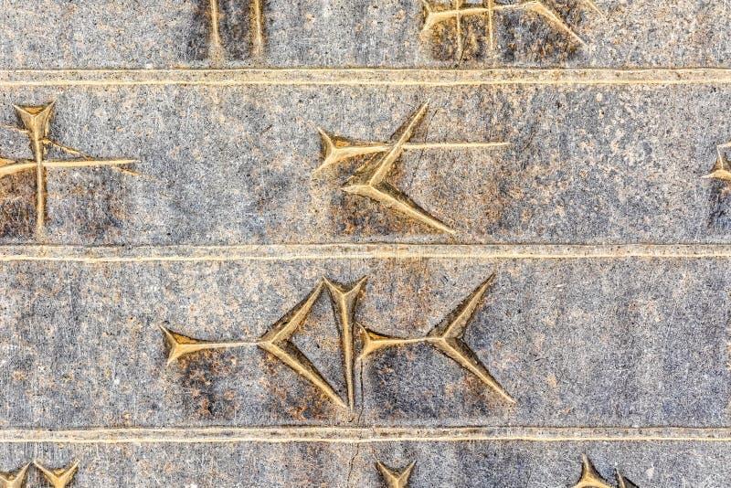 Kilskrift- closeup Persepolis arkivfoton