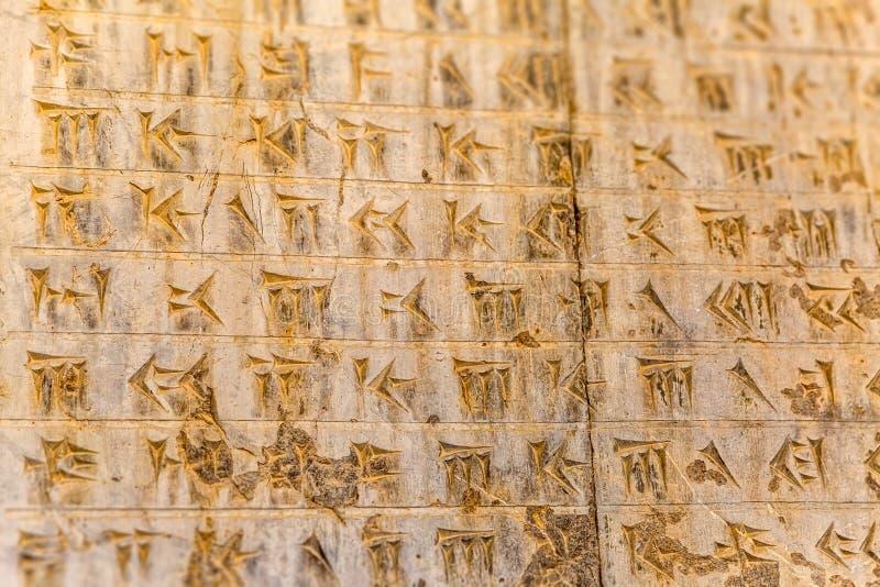 Kilskriften märker Persepolis arkivfoto