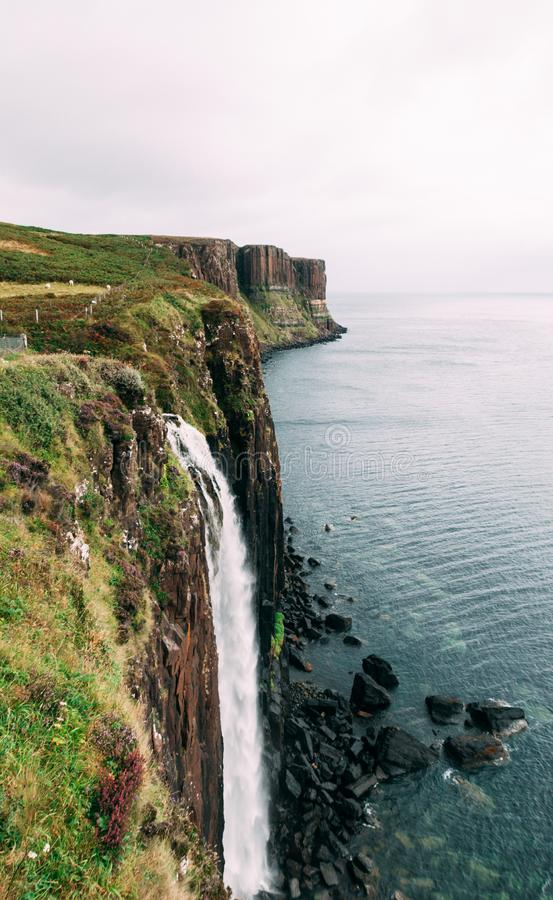 Kilt rock and waterfall in Scottish highlands on the Isle of Skye, Scotland, United Kingdom royalty free stock photography