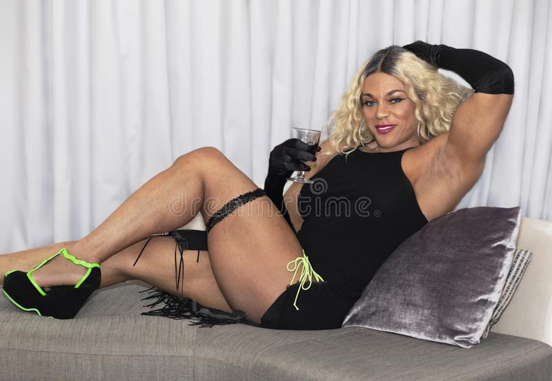 Kim Buck, Enticing Woman Bodybuilder. Sultry female professional bodybuilder Kim Buck from Georgia strikes an inviting pose. In this photo Buck is in her off royalty free stock photography