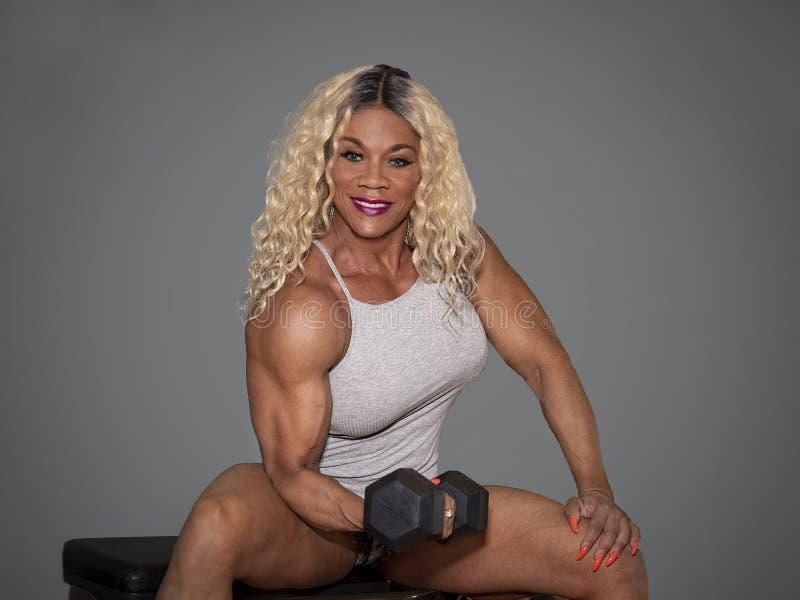 Kim Buck, mujer de tentación Bodybiolder se resuelve imagen de archivo