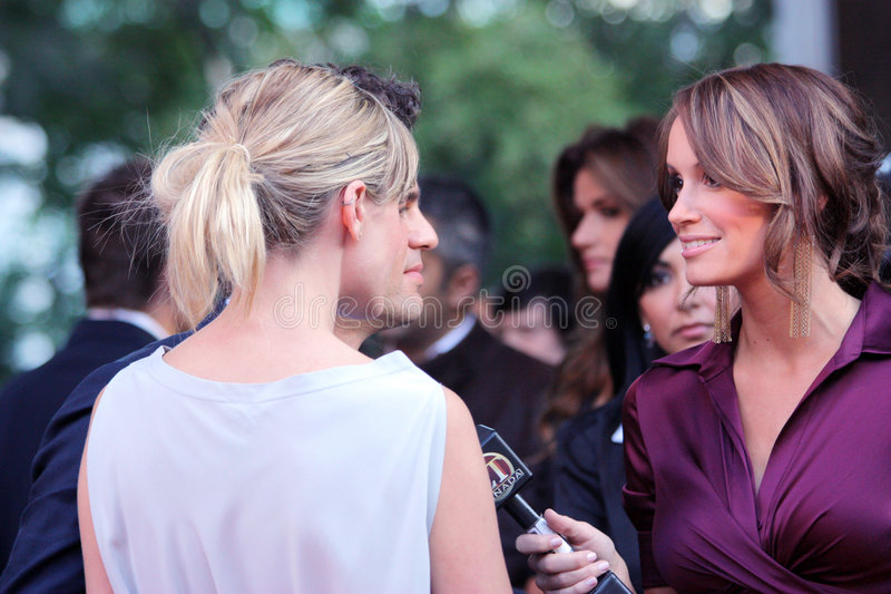 Kim D'Eon. (full name Kimberley Jan D'Eon) , Senior Entertainment Tonight Reporter, interviewing celebrities at the premiere of What Doesn't Kill You during the royalty free stock photos