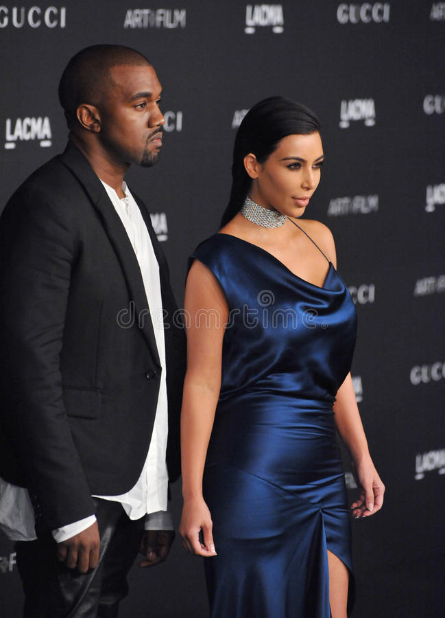 Kim Kardashian & Kanye West. LOS ANGELES, CA - NOVEMBER 1, 2014: Kim Kardashian & Kanye West at the 2014 LACMA Art+Film Gala at the Los Angeles County Museum of stock images