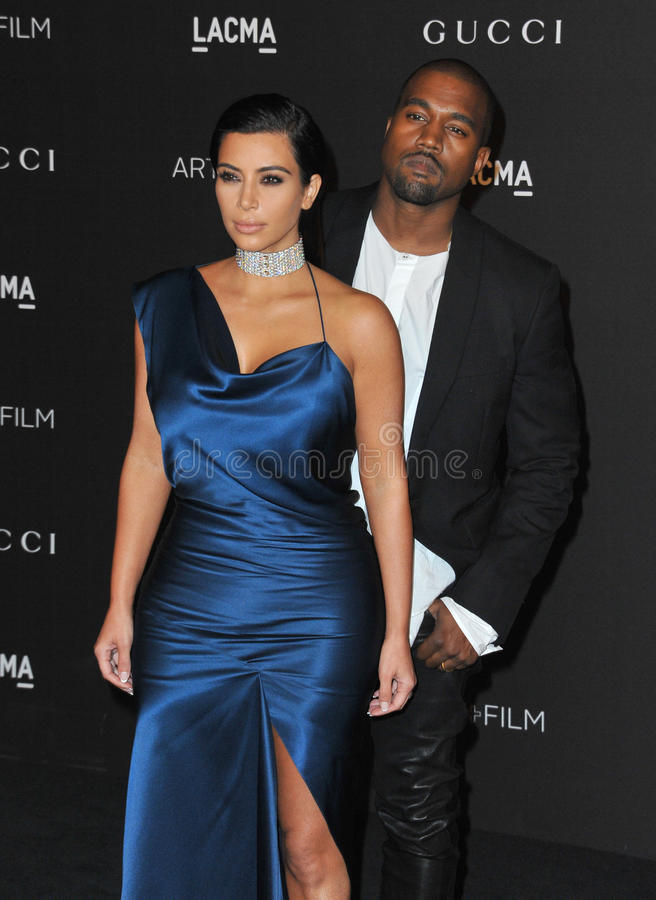 Kim Kardashian & Kanye West. LOS ANGELES, CA - NOVEMBER 1, 2014: Kim Kardashian & Kanye West at the 2014 LACMA Art+Film Gala at the Los Angeles County Museum of stock photo