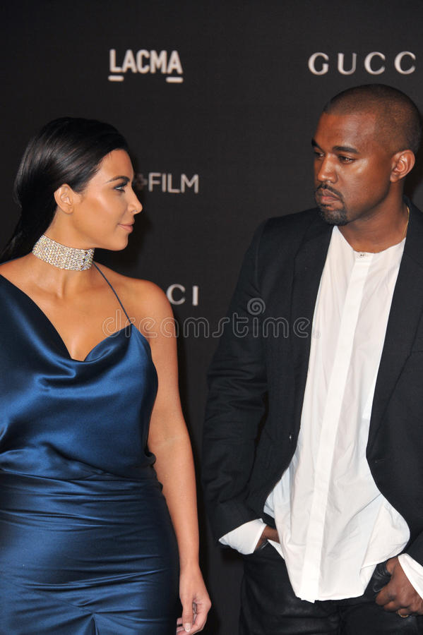 Kim Kardashian & Kanye West. LOS ANGELES, CA - NOVEMBER 1, 2014: Kim Kardashian & Kanye West at the 2014 LACMA Art+Film Gala at the Los Angeles County Museum of stock photography