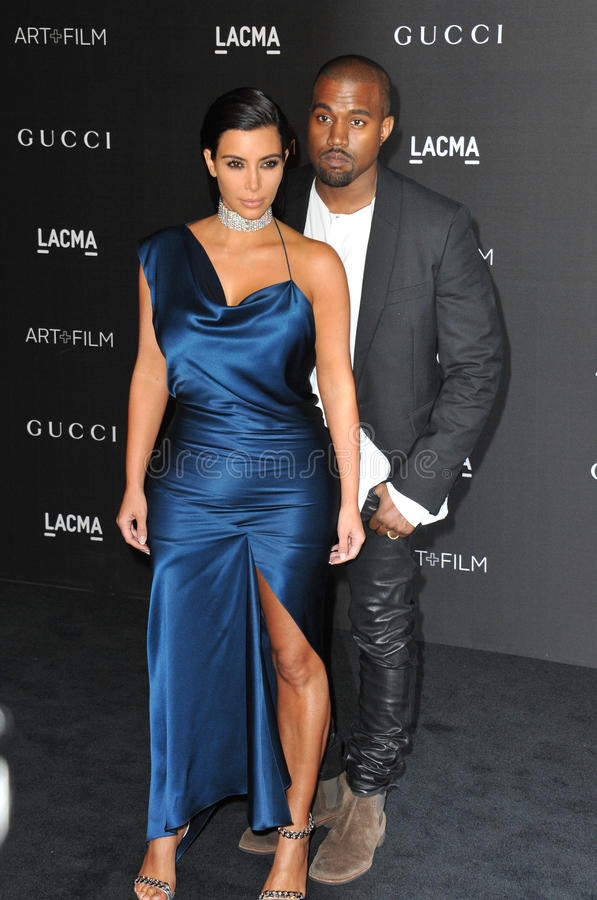Kim Kardashian & Kanye West. LOS ANGELES, CA - NOVEMBER 1, 2014: Kim Kardashian & Kanye West at the 2014 LACMA Art+Film Gala at the Los Angeles County Museum of royalty free stock image