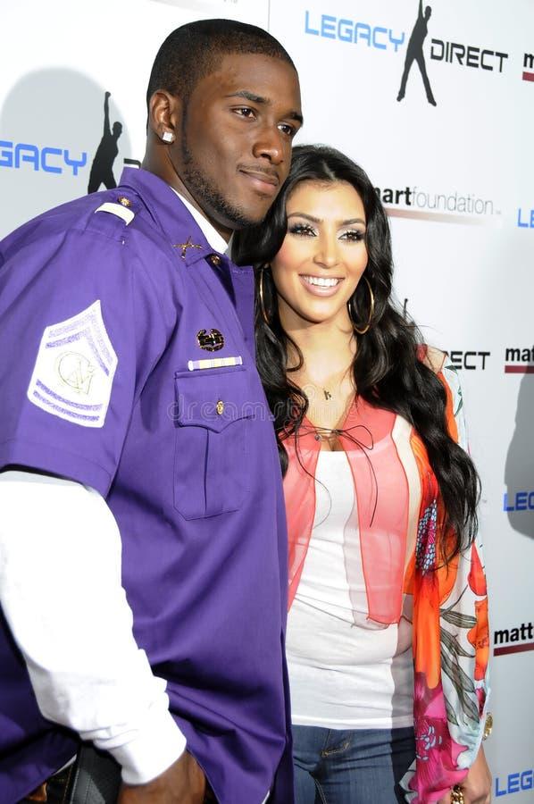 Kim Kardashian and Reggie Bush stock photography