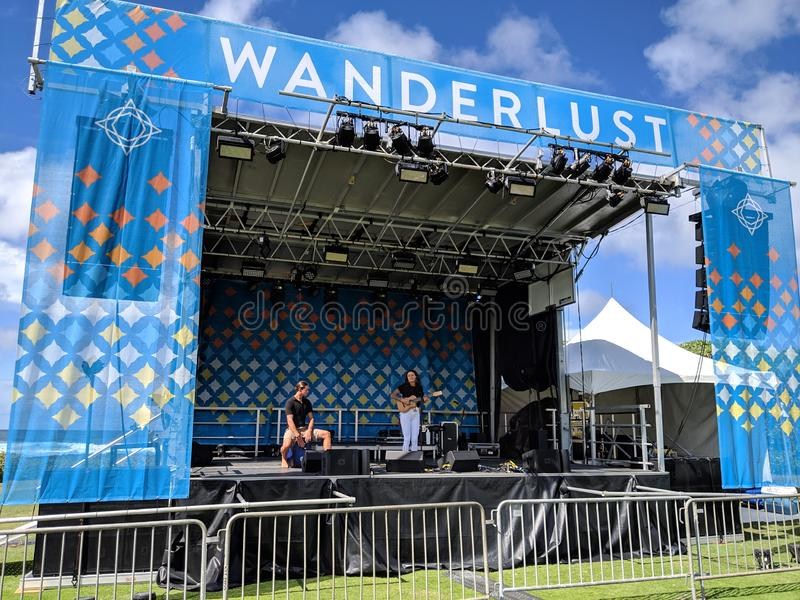 Kimberly June preforms on stage during day. North Shore, Hawaii - March 1, 2019:  Kimberly June preforms on stage during day at outdoor Music festival Wanderlust stock image