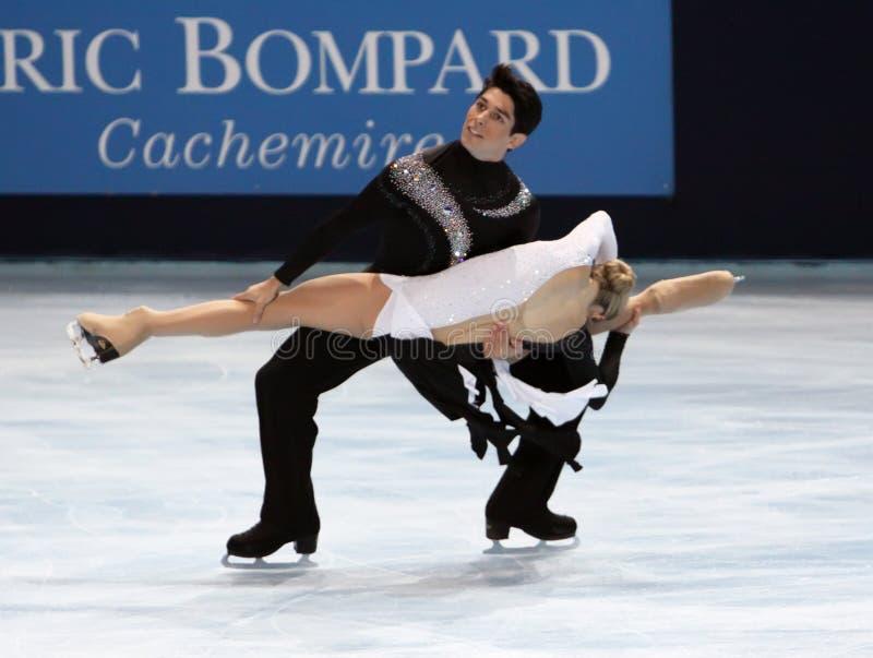 Kimberly NAVARRO / Brent BOMMENTRE (USA). PARIS - OCTOBER 17: Kimberly NAVARRO and Brent BOMMENTRE of USA perform free dance at the ISU Grand Prix Eric Bompard stock image