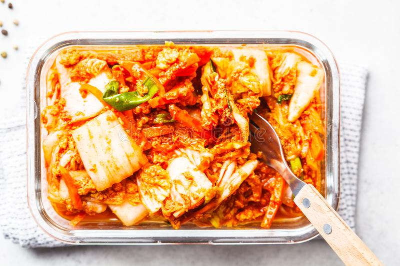 Kimchi cabbage in glass container, white background. Korean food, probiotics food royalty free stock photo