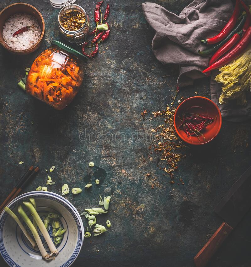 Free Kimchi Preserving. Homemade Fermented Chinese Cabbage In Hot Chili Sauce In Jar On Dark Rustic Background With Ingredients. Top Stock Photography - 169747552