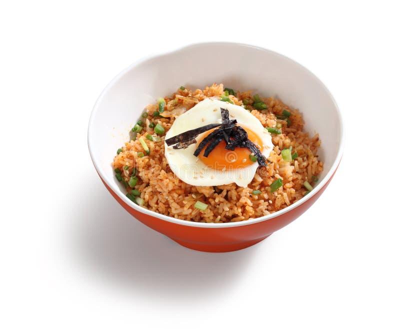 Kimchi rice bowl. With egg on white background stock image
