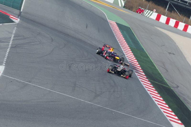 Kimi Raikkonen - Markierung Webber - Montmelo lizenzfreie stockfotos