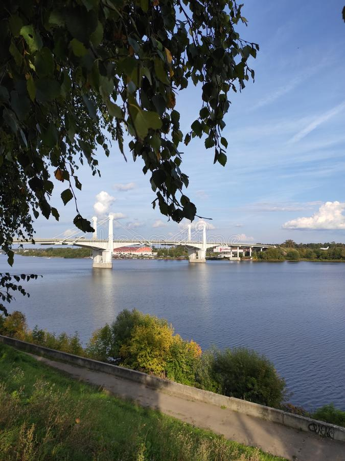 Kimry, Tver Region, Russia - September 1, 2019: The view of the bridge over the Volga river from the Fadeev embankment. On a sunny day royalty free stock photos