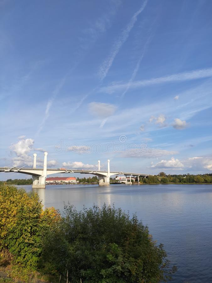 Kimry, Tver Region, Russia - September 1, 2019: The view of the bridge over the Volga river from the Fadeev embankment. On a sunny day stock image