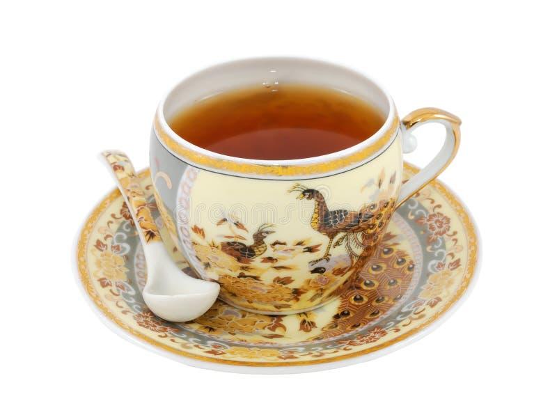 Kina teacup med skeden royaltyfria bilder