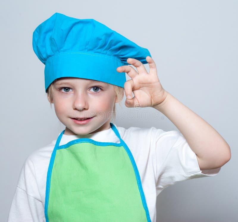 Kind als chef-kokkok royalty-vrije stock afbeeldingen