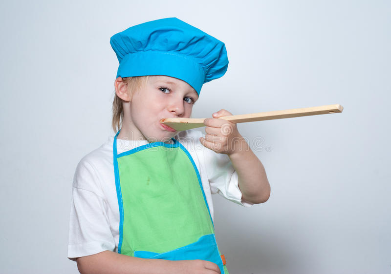 Kind als chef-kokkok stock foto's